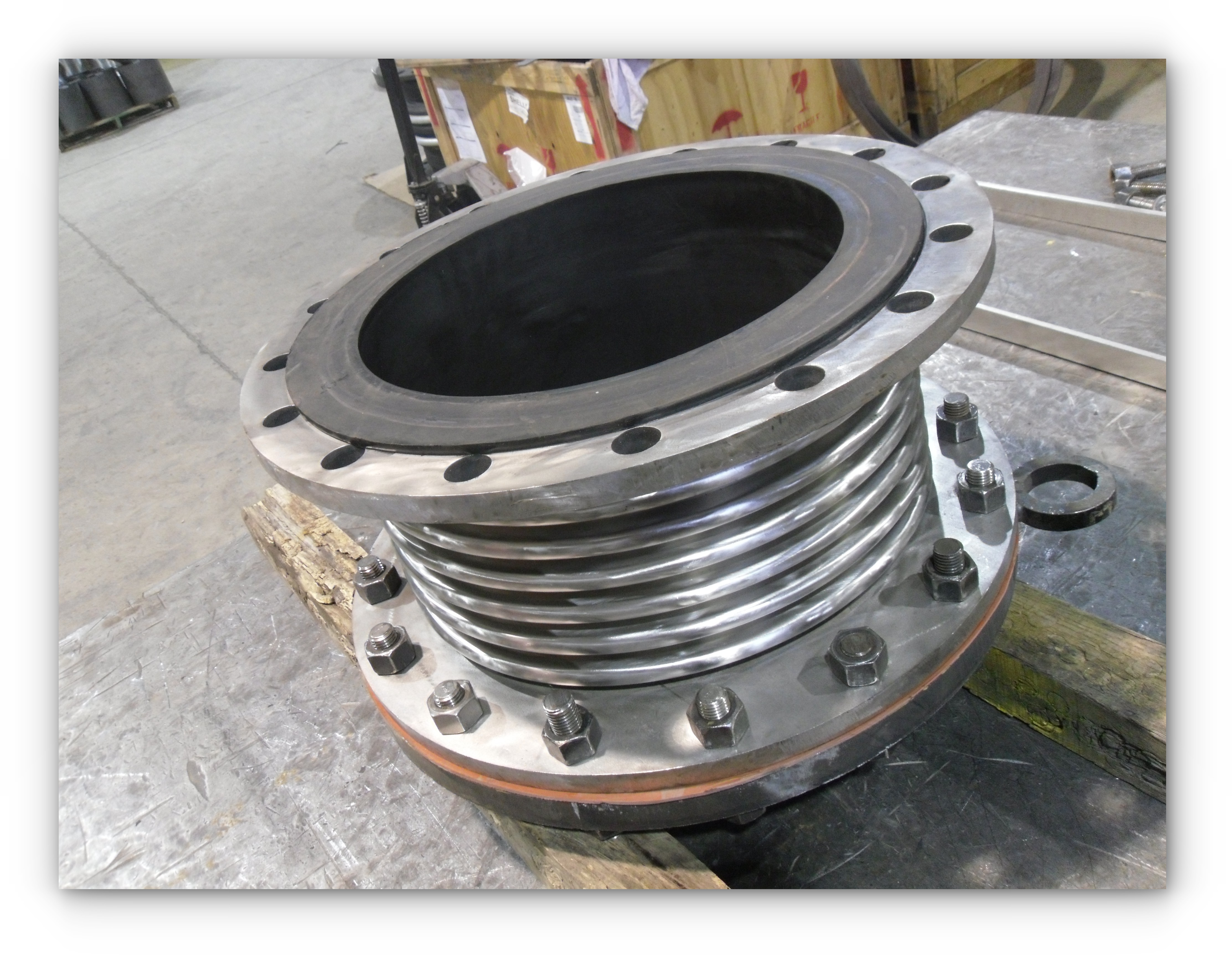 Metallic bellows with elastomeric lining used for solid loaded media for oil sand project in Fort Hills Alberta. Bellows made of Inconel 625, 5 plies with leak detector between plies. Design Pressure 3700 kPa, Size 16""